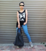 April - I am wearing a Religion mini dress with distressed jeans, hi-top wedges and accessorised it with an oversized fabric bag.
